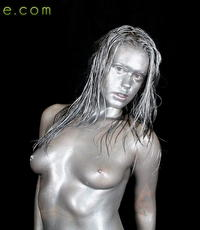 Metallic hottie. Slut covers herself in metallic paint and fucks her booty hartd with dildos