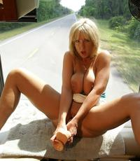 Large toys in public. Horny blonde dildos herself in the window of an RV going down the road