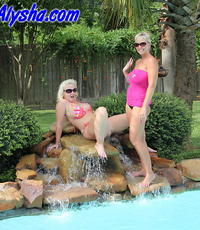 Hot blondes by the poolside. Alysha and Mrs Siren fist each other while relaxing in the pool.