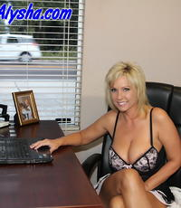 Rough day at the office. Alysha gets a little work done at the office with the blinds wide open.