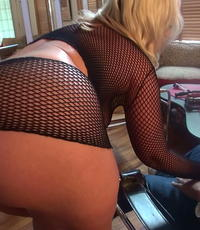 Foxy in fishnets. Smokin hot blonde has a little tool action dressed in a lustful fishnet outfit.