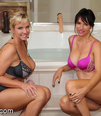 Beauty bath time. Two smokin hot beauties share a bath and have